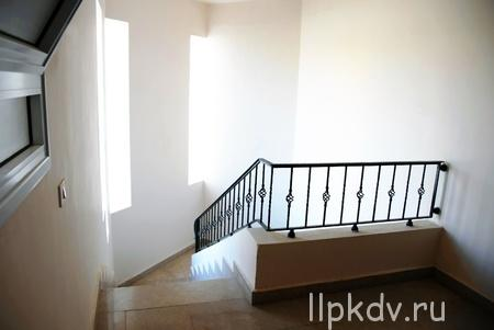 13444588 - building interior details, staircase with iron railing